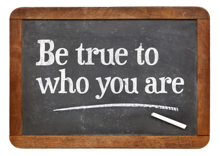 self development: Be true to who you are - inspirational advice  on a vintage slate blackboard Stock Photo