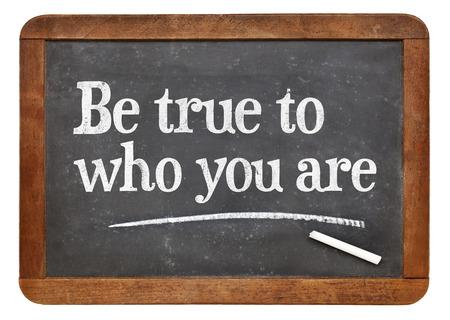 Be true to who you are - inspirational advice  on a vintage slate blackboard Stock Photo