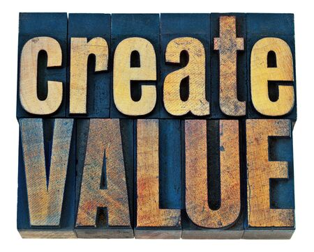 letterpress words: create value typography - inspiration concept - isolated words in vintage letterpress wood type blocks Stock Photo