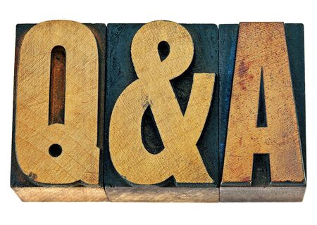 qa: Q&A - questions and answers acronym - isolated text in vintage letterpress wood type printing blocks Stock Photo