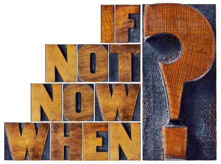 action: if not now, when question  - call for action or decision - isolated word abstract in vintage letterpress wood type Stock Photo