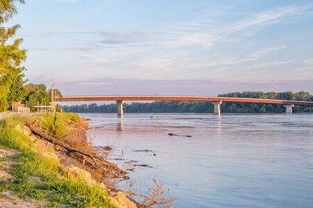 riverfront: Missouri River, riverfront and bridge at Hermann in sunrise light, high water level
