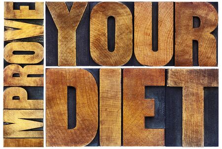 wood type: improve your diet - healthy lifestyle concept - isolated text in vintage letterpress wood type printing blocks Stock Photo