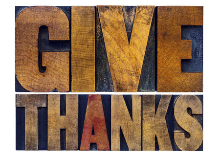 thanks: give thanks - Thanksgiving concept - isolated word abstract in letterpress wood type with ink patina Stock Photo