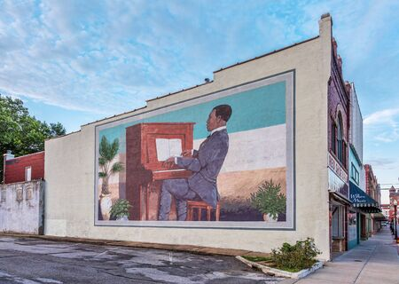 scott: SEDALIA, MO, USA - AUGUST 3, 2015: Scott Joplin plays Maple Leaf Rag on piano - a large building wall mural by Stanley James Herd in historic downtown of Sedalia, Missouri.