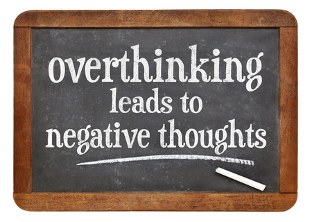 Overthinking leads to negative thoughts - warning on a vintage slate blackboard