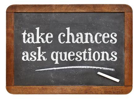 chances: Take chances, ask questions - motivational advice on a vintage slate blackboard Stock Photo