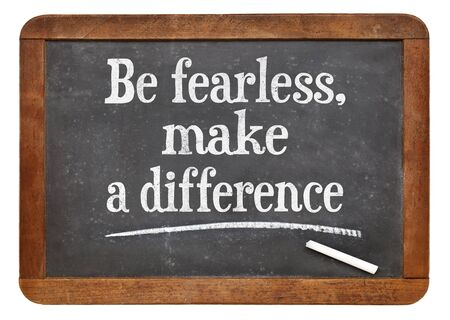 difference: Be fearless, make a difference  - motivational text  on a vintage slate blackboard