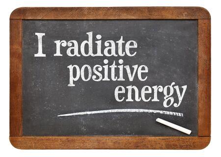 radiate: I radiate positive energy - positive affirmation words on a vintage slate blackboard