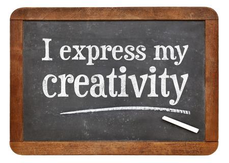 affirmation: I express my creativity positive affirmation on a vintage slate blackboard