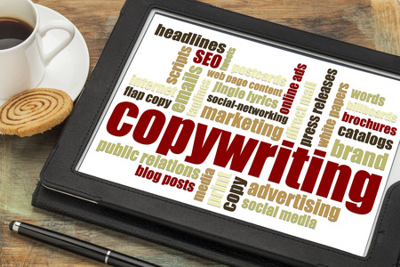 copywriting: copywriting word cloud on a digital tablet with a cup of coffee