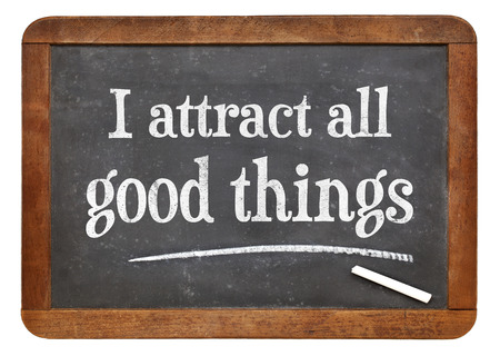 affirmation: I attract all good things - positive affirmation  words on a vintage slate blackboard
