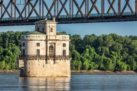 st louis: Historic water intake tower number 2 built in 1915 and the Old Chain of Rocks bridge on the Mississippi River near St Louis