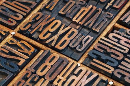 typesetter: vintage letterpress wood type printing blocks in a typesetter drawer