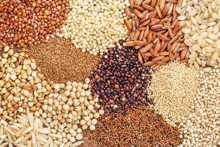 gluten free grains (buckwheat, amaranth, brown rice, millet, sorghum, teff,  red, black and white quinoa) - top view background