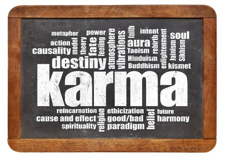 cause and effect: karma word cloud on a vintage slate blackboard isolated on white - spirituality concept
