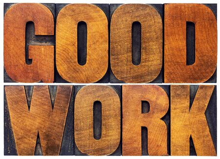 wood type: good work word abstract - isolated text in letterpress wood type