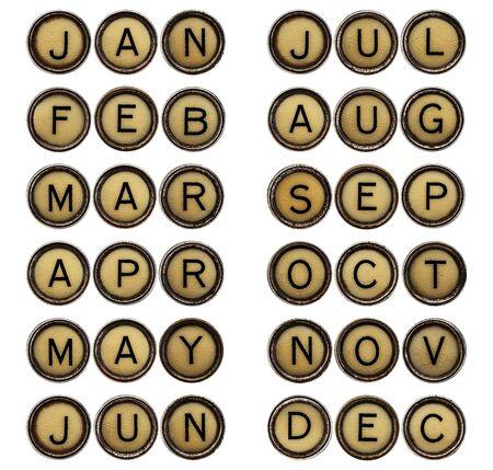 maquina de escribir: doce meses de enero a diciembre (3) s�mbolos de letras en las teclas aisladas m�quina de escribir de la vendimia Foto de archivo