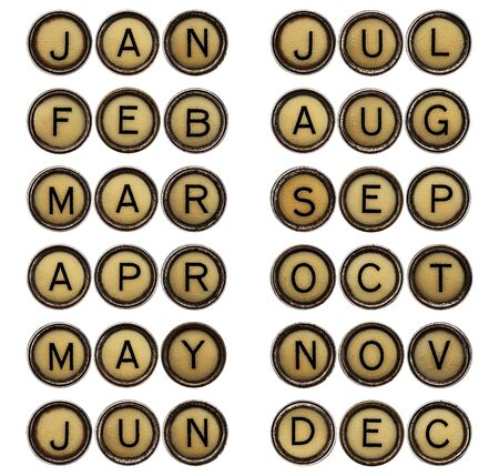 typewriter key: twelve months  from January to December ( 3 letter symbols) in isolated vintage typewriter keys