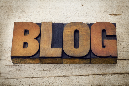 blog - a word in vintage letterpress wood type on a grunge white painted barn wood background