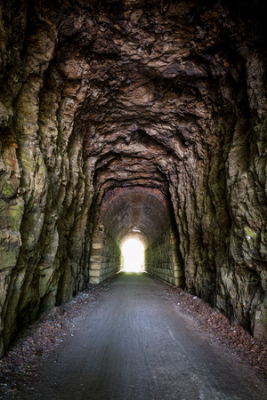 end of the trail: light at the end of the tunnel - MKT Katy Trail at Rocheport, Missouri. The Katy Trail is 237 mile bike trail stretching across most of the state of Missouri converted from an old railroad. Stock Photo