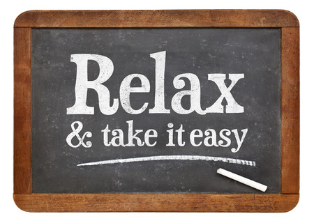 take it easy: Relax and take it easy - advice on a vintage slate blackboard