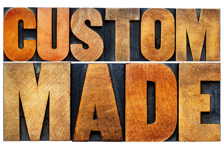 custom made: custom made word abstract - isolated text in vintage letterpress wood type printing blocks