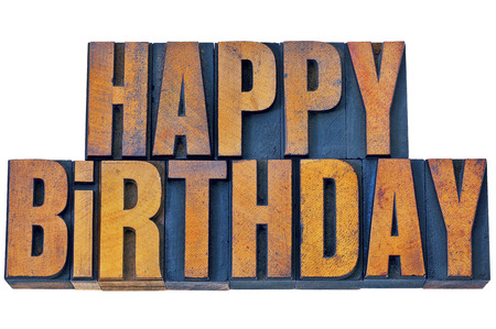 letterpress words: happy birthday greetings - isolated words in vintage letterpress wood type printing blocks stained by color inks Stock Photo