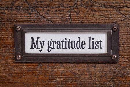 agradecimiento: Mi lista de gratitud - una etiqueta en un archivador de madera del grunge Foto de archivo