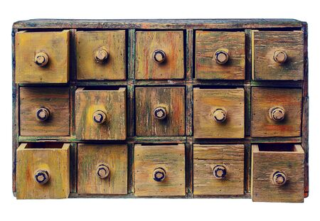 primitive wooden apothecary or catalog cabinet with partially open drawers - storage and sorting concept or just retro background