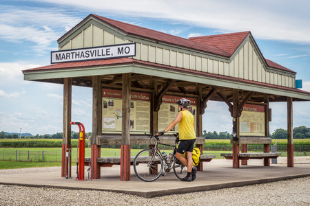 bike trail: MARHTSVILLE, MO, USA - AUGUST 1, 2015: A touring cyclist at Marthasville station on Katy Trail (237 mile bike trail stretching across most of the state of Missouri converted from abandoned railroad) Editorial