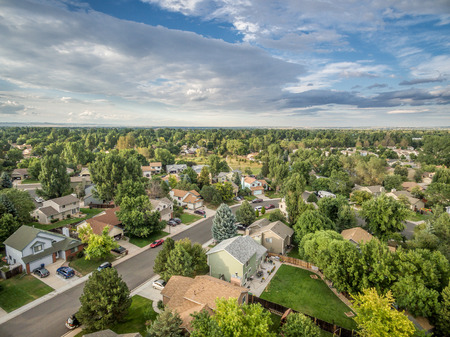 fort collins: FORT COLLINS, CO, USA - AUGUST 27, 2015: Aerial view of Fort Collins at late summer, a typical residential street along Front Range of Rocky Mountains in Colorado with 30 years old houses Editorial