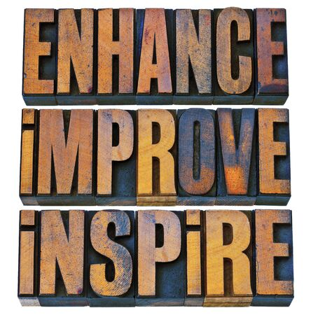 letterpress words: enhance, improve, inspire - a collage of isolated motivational words in vintage letterpress wood type printing blocks