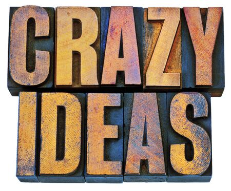 woodtype: crazy ideas - creativity concept - isolated text in vintage  letterpress woodtype printing blocks