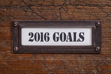 file cabinet: 2016 goals  - a label on a grunge wooden file cabinet, New Year goals and resolutions concept
