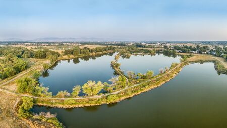 aerial panorama view of Riverbend Ponds, one of natural areas in Fort Collins, Colorado along the Poudre River converted from gravel quarry for recreation Stock Photo
