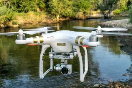 poudre river: FORT COLLINS, CO, USA, AUGUST 29, 2015:  Airborne radio controlled Phantom 3 quadcopter drone flying with a camera over the Poudre RIver.