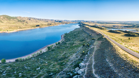 collins: aerial panorama of northern part of the Horsetooth Reservoir with Centennial Road and hiking trails, Fort Collins, Colorado, late summer scenery