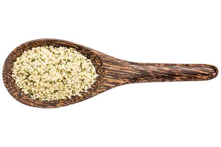 hemp hemp seed: hemp seeds hearts on a wooden spoon isolated on white Stock Photo