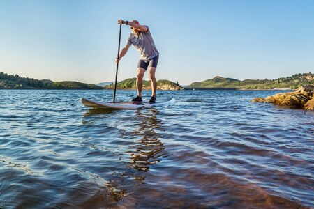 paddling: stand up paddling workout on Horsetooth Reservoir at foothills of Rocky Mountains near Fort Collins, Colorado, summer scenery