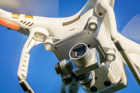 FORT COLLINS, CO, USA, SEPTEMBER 3,  2015:  Close up view of the DJI Phantom 3 quadcopter drone flying with a camera.