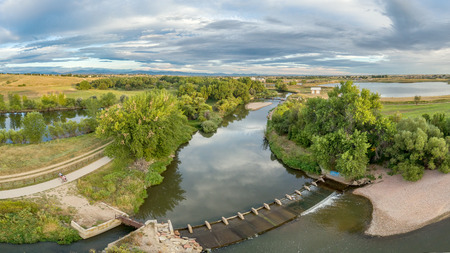 aerial panorama of the Cache la Poudre River with diversion dams and bike trail - Poudre River Trail Imagens