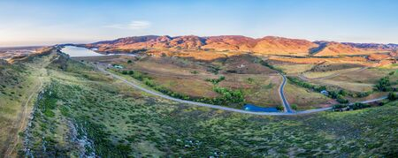 collins: aerial panorama of foothills near Fort Collins, Colorado with Horsetooth Reservoir, Lory State Park, Charles Hansen Canal and Centennial Road, sunrise at late summer Stock Photo
