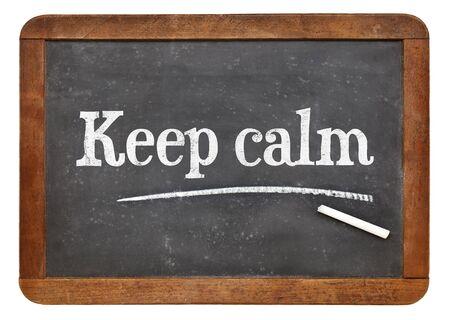 keep: Keep calm advice or reminder - white chalk text on a vintage slate blackboard