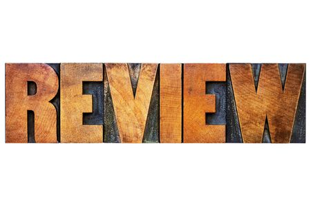 review word - isolated text in letterpress wood type printing blocks stained by color inks