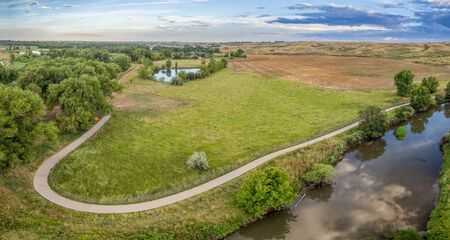 extending: aerial panorama of Poudre River Trail bear Windsor, Colorado - a paved bike trail extending for more than 20 miles between Timnath and Greeley