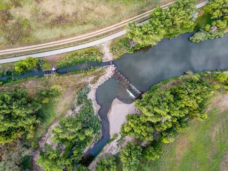 cache la poudre river: aerial view of the diversion dam providing water for farming - Cache la Poudre River near WIndsor, Colorado Stock Photo