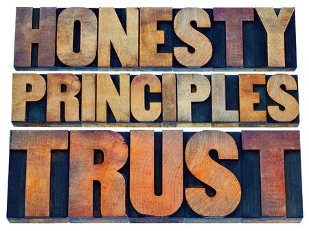 trust: honesty, principles and trust word abstract - isolated text in vintage letterpress wood type Stock Photo