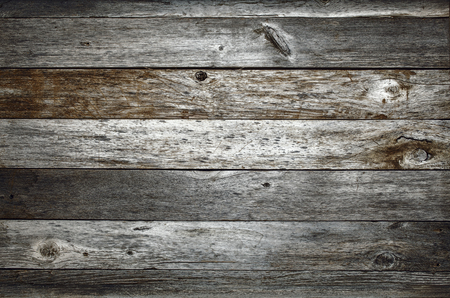 wood texture: dark rustic weathered barn wood background with knots and nail holes