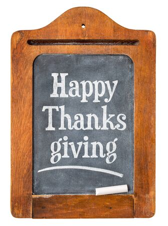 thanksgiving day: Happy Thanksgiving - white chalk text  on a small slate message blackboard isolated on white